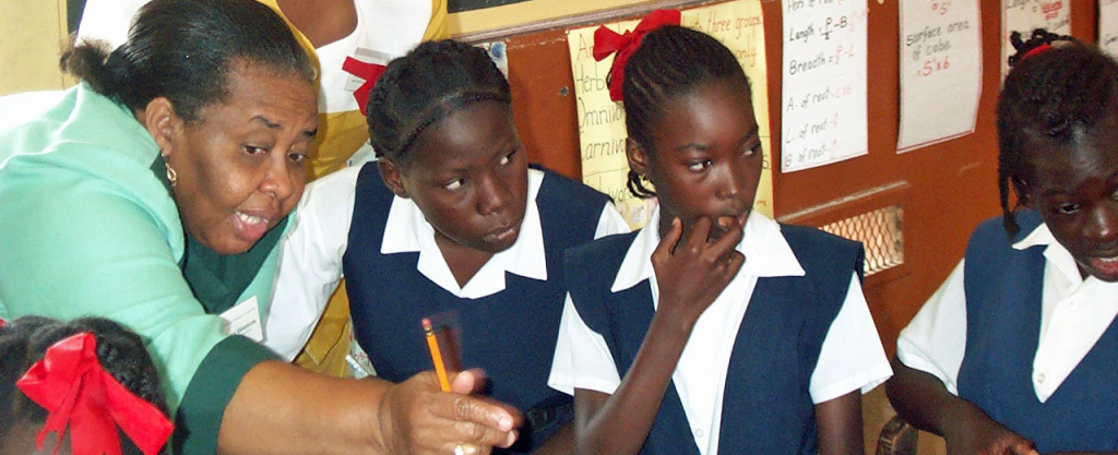 Teacher teaching 3 girls - Tobago